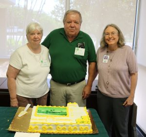 From left, Peggy and John Boa, Friends of the Library members; and Isabelle Fetherston, Branch Supervisor for the Ruskin Library, serve cake at the 50th anniversary celebration June 8. CHERE SIMMONS PHOTOS