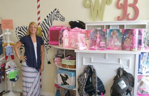 Photos courtesy of Mandy Cassiano Wee Boutique's owner, Mandy Cassiano, shows off some of the toys and accessories available in her shop.