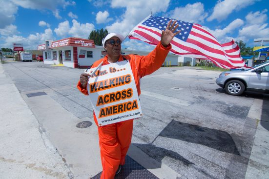 For the past 16 years, Kim Denmark has walked more than 5,100 miles across 16 states and is on her 29th pair of tennis shoes. She is walking to raise awareness for the homeless and those stricken by poverty. She attends to all, but her focus is on homeless veterans and families. Along U.S. 41 there were no shortage of drivers honking and waving. She smiled and waved back to each one. MITCH TRAPHAGEN PHOTOS