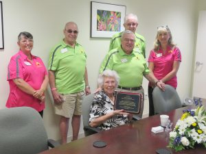 "Community Association President David Floyd, in presenting Doris Ragland a plaque from the CA, said ""We are really fortunate that you have been such an important part of our community for so many years."" Also attending were (from left) Directors Marilyn Cote-Miller, Sam Sudman, Joe Elam and Community Manager Lyn Reitz."