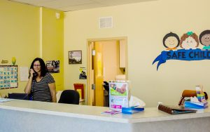 Joli Beaney, a Centerstone employee, helps out at the front desk of the Bradenton Safe Children's Coalition office.