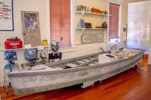 An almost 70-year-old pole skiff from Siesta Key on display.