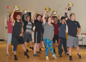 The chorus line goes through one of their dance routines during rehearsal of the Manatee Players' production of 42nd Street.