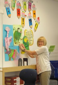 Language arts teacher Cindy Williams works to get her classroom ready for the new school year at Manatee School for the Arts.