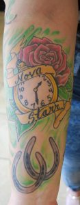 The tattoo on the right forearm of Megan Ryan memorializes the time of birth of her daughter, Nova Starr.