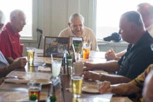 Socha at the head of the table during his surprise 95th birthday party at Little Harbor Resort on Friday.
