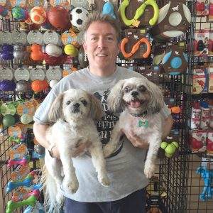 LOIS KINDLE PHOTO Dog Gone Holistic co-owner Darrel Day holds his two Shih Tzus, Chaz, left, and Basil, at the new Dog Gone Holistic location at 13131 U.S. 301 S., Riverview. The store opens Friday.