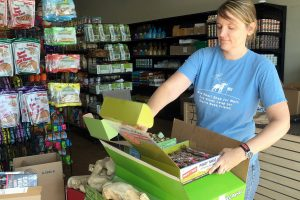 Kim Cullins, Dog Gone Holistic's Riverview store manager, checks out a new shipment of pet supplies as the store is readied for its soft opening Aug. 12