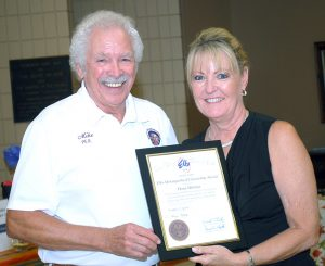 LARRY BRIGANT PHOTO Representing the Grand Lodge of the Benevolent and Protective Order of Elks and South Hillsborough Elks Lodge 2672, Past Exalted Ruler Mike Kent poses with Kings Point resident Dana Dittmar after giving her the Elks District Citizenship Award, one of the organization's highest recognitions, at the Wimauma Convention Center Aug. 18.