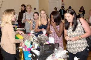 HUTH & BOOTH COURTESY PHOTOS New teachers or those new to Riverview area schools line up to receive their oversized gift bags of school supplies and other items. The giveaway was part of the Greater Riverview Chamber's annual Teaching to Excellence Breakfast, held on Aug. 5 at The Regent.