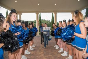 The Riverview High School cheerleading team gave a rousing welcome to everyone who entered The Regent at the Greater Riverview Chamber of Commerce's annual Teaching to Excellence Breakfast Aug. 5.