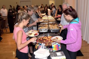 Attendees line up for the catered Teaching to Excellence breakfast, which was provided to new teachers at no charge on Aug. 5 by the Greater Riverview Chamber of Commerce.