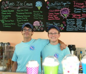 Lisa Stark PHOTO Co-owner Adam Souza, left, pauses with employee Colin Boyle behind the counter at Kimi's Ice Cream and Coffees.