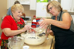 Frances Hereford, of the Firehouse Cultural Center, and Charlotte Clark, of American Momentum Bank in Sun City Center, prepare blueberry pancakes at the SouthShore Chamber's annual New Teacher Breakfast Aug. 5. Dee and Anthony Fridella, Wendy Yeo and Polly Rothenbush also helped cook the free meal.