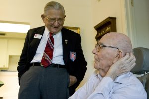 Cmdr. Socha visits with World War I veteran Harry Landis at Sun Towers in Sun City Center in 2007. Landis was then one of the nation's last WWI survivors. Today, none remain.