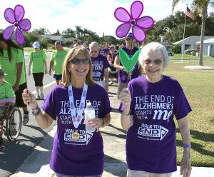 """COURTESY PHOTO of ELLEN KLEINSCHMIDT Ellen Kleinschmidt, left, participates in the 2015 Walk for a Cure with her mother, Ginny Zweig, 84, who was diagnosed with Alzheimer's eight years ago. Kleinschmidt says she performs in benefits like """"Unforgettable"""" to fund Alzheimer's research so that one day the world will be free of the disease."""