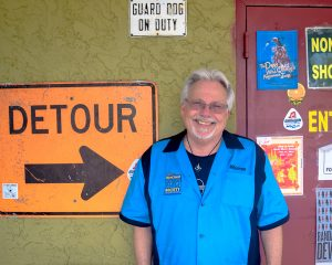 Warren McDougle, the Suncoast Blues Society's public relations representative, poses outside Aces Live after making time for an interview.
