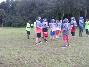 Josiah Davis, far left, athletic director and senior team head coach for the SouthShore Sharks Athletic Club Inc., drills the senior team for its next game. An active duty Navy Chief at MacDill AFB in Tampa, and resident of Ruskin for 19 years, Davis saw a need for the children all over South County from Wimauma to Riverview and together with a few willing volunteers from the base and the communities, began the club and worked for a year to get it approved as a 501(c)3 nonprofit (tax deductible) organization. Those who work with these 4 through 15 year olds say most of them could not participate in sports before due to two things: Transportation to practice and games; and the cost of uniforms. This group is reaching out to individuals and organizations and have already had some recognition from the Tampa Bay Buccaneers.