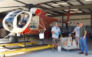 CARL MARIO NUDI PHOTO Helicopter pilots Art Shiver, left, and John Bautista, center, stand with Manatee County Mosquito Control District director Mark Latham in front of one of three helicopters the district owns.