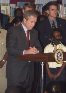 President George W. Bush during a moment of silence at Booker Elementary School on the morning of September 11, 2001.