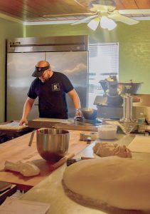 Owner Dana Johnson enjoys working collaboratively with other businesses. Here he makes tortillas for Poppo's Taqueria.