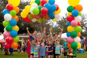 PAM VASQUEZ PHOTO Family and friends who helped organize the ABC Superhero Fun Run gather for a group photo during the inaugural event at Covington Park in 2014. The event will take place this year at East Bay High School, 7710 Old Big Bend Road, Gibsonton.