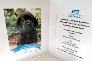 LOIS KINDLE PHOTO At Southeastern Guide Dogs, it all starts with the puppies. Shown is a black Labrador pup named Keith named by Keith G. Hirst. Individuals who contribute at least $5,000 or businesses that provide that amount in in-kind donations receive the honor of naming a future super hero.