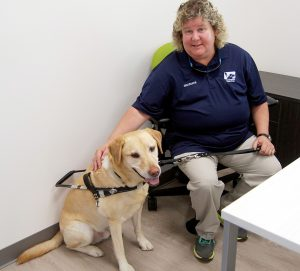 LOIS KINDLE PHOTO Suzy Wilburn, director of admissions and graduate services at Southeastern Guide Dogs, and her guide dog, Carson, check out their new office on the first floor of the new Barpal–Hirst Student Center.