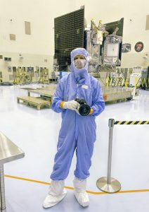 George Fleenor/Full Dome FX Multimedia PHOTO Photographer Troy McClellan captures images of the OSIRIS-REx spacecraft during processing in the high-bay clean room facility at Kennedy Space Center.