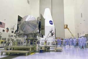 Troy McClellan/Full Dome FX Multimedia photo Members of the media view and photograph the OSIRIS-REx space craft and Atlas V Payload Fairing in the high-bay clean room facility at Kennedy Space Center.