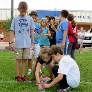 Josh Katz watches Jaylen Morris and Isaac Cassiano, of Apollo Beach Elementary School, plant their pinwheels on International Day of Peace, Sept. 21.