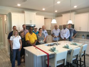 Members of Lennar Home and the SouthShore Chamber of Commerce gather in the kitchen of the waterfront model home in Ruskin. The model is 3,835 square feet Jupiter floor plan, with five bedrooms and a loft.