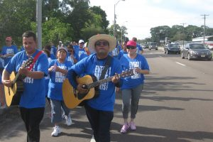 Musicians strum guitars during the 2015 Walk for the Poor, which will once again take place this year along U.S. 41 from St. Anne Catholic Church to College Avenue and back on Sept. 24.