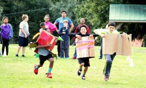 Students in the after school program at the YMCA Camp Cristina will benefit from the donations earned by Tammy Holmberg as the winner of the Riverview Chamber of Commerce Honorary Mayor's race. The photo above shows kids participating in a handmade cart race.
