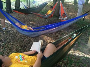 At Camp Cristina after school programs, kids can use the reading hammocks to relax and enjoy a good book.