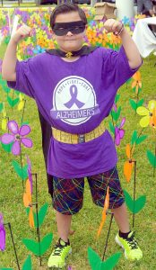 SHARON RABOIN PHOTO Dylan Bramble, of Team Purple Power, walked as a superhero named Capt. Cure in the recent 2016 South Shore Walk to End Alzheimer's in Sun City Center.
