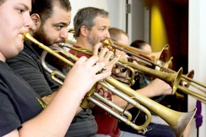 """Brass section members of the South Shore Symphony Orchestra practice a number for """"Destinations,"""" the first concert of their 2016-2017 season."""