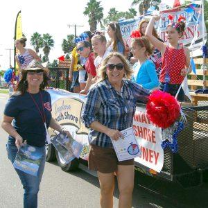 Melanie Rimes, left, and Leslie Bennett, of the SouthShore Chamber of Commerce, walk alongside the chamber's float during the 2015 Ruskin VFW Veteran's Day Parade.