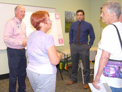 Manatee County Parks and Natural Resources Department Director Charles Hunsicker, left, gathers input from county residents at a meeting in the Rocky Bluffs Library on Dec. 7. CARL MARIO NUDI PHOTO