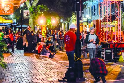"""Festivalgoers wait for the performance to begin along Main Street in downtown Bradenton during """"Sounds of the Season."""""""