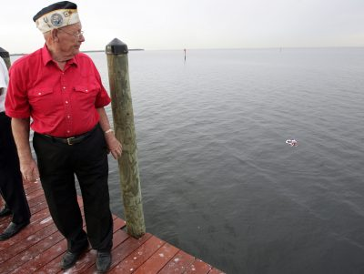 Pearl Harbor Survivor Ed Warren glances back at the wreath after the 2006 Pearl Harbor Day ceremony held at Little Harbor in Ruskin. He said he remembered Dec. 7, 1941 as though it were yesterday. In taking this photo, I could imagine his thoughts.