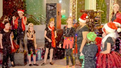 """Students from Mrs. Patricia Ross's thespian troupe of the Manatee School For The Arts perform a holiday skit at the """"Sounds of the Season"""" event in downtown Bradenton, Saturday, Dec. 10."""