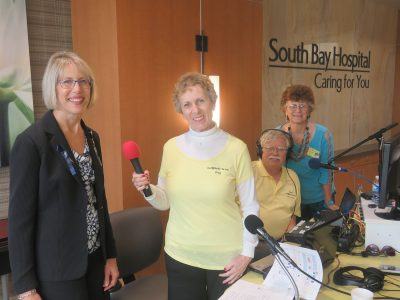 """Sun City Center's own Sun Radio was on the scene broadcasting live at South Bay Hospital's public """"sneak peek"""" of the new patient tower expansion on Dec. 5. Here Peg Goodenow interviews Chief Executive Officer Sharon Roush."""