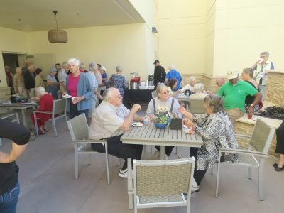 Guests enjoyed cake and punch in the courtyard following their tour of the hospital's patient tower expansion.