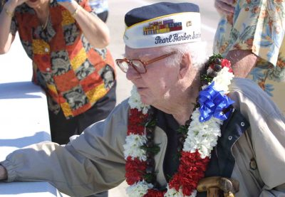 From the Ruskin VFW Pearl Harbor Day ceremony in 2002: Survivor Ron Warren watches the wreath float down the Little Manatee River.