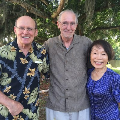 Famed artist Fred Rothenbush, center, poses with artists Tom and Hatsumi Day. Tom Day overcame the odds of a stroke to become a highly talented and unique artist in his own right. As he learned, his wife discovered her passion for creating art. PHOTO BY DOLORES COE